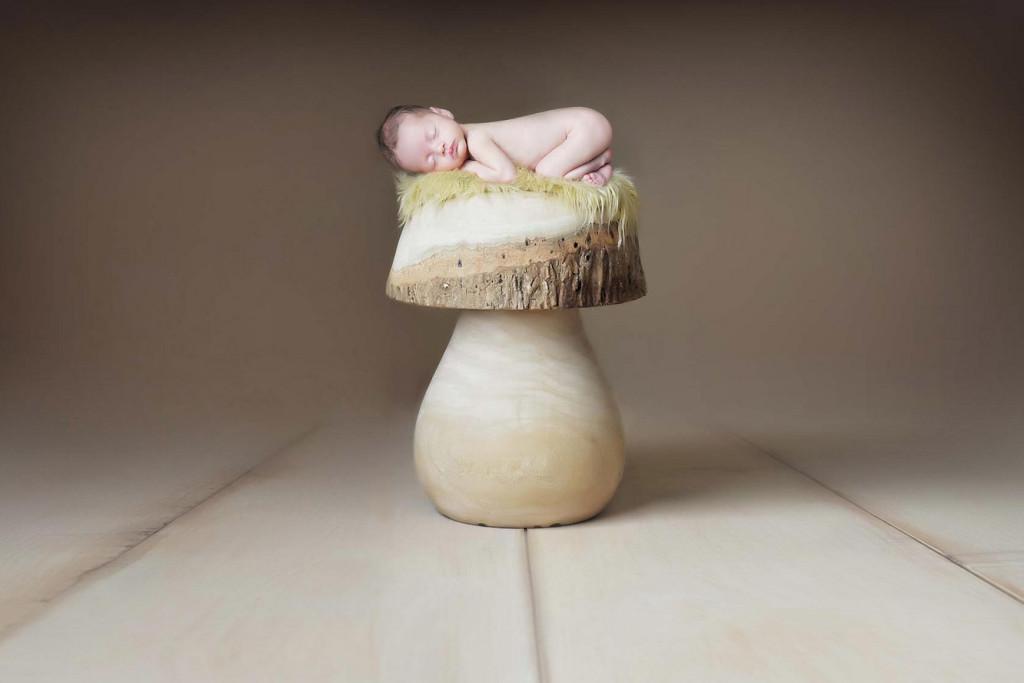 newborn on mushroom